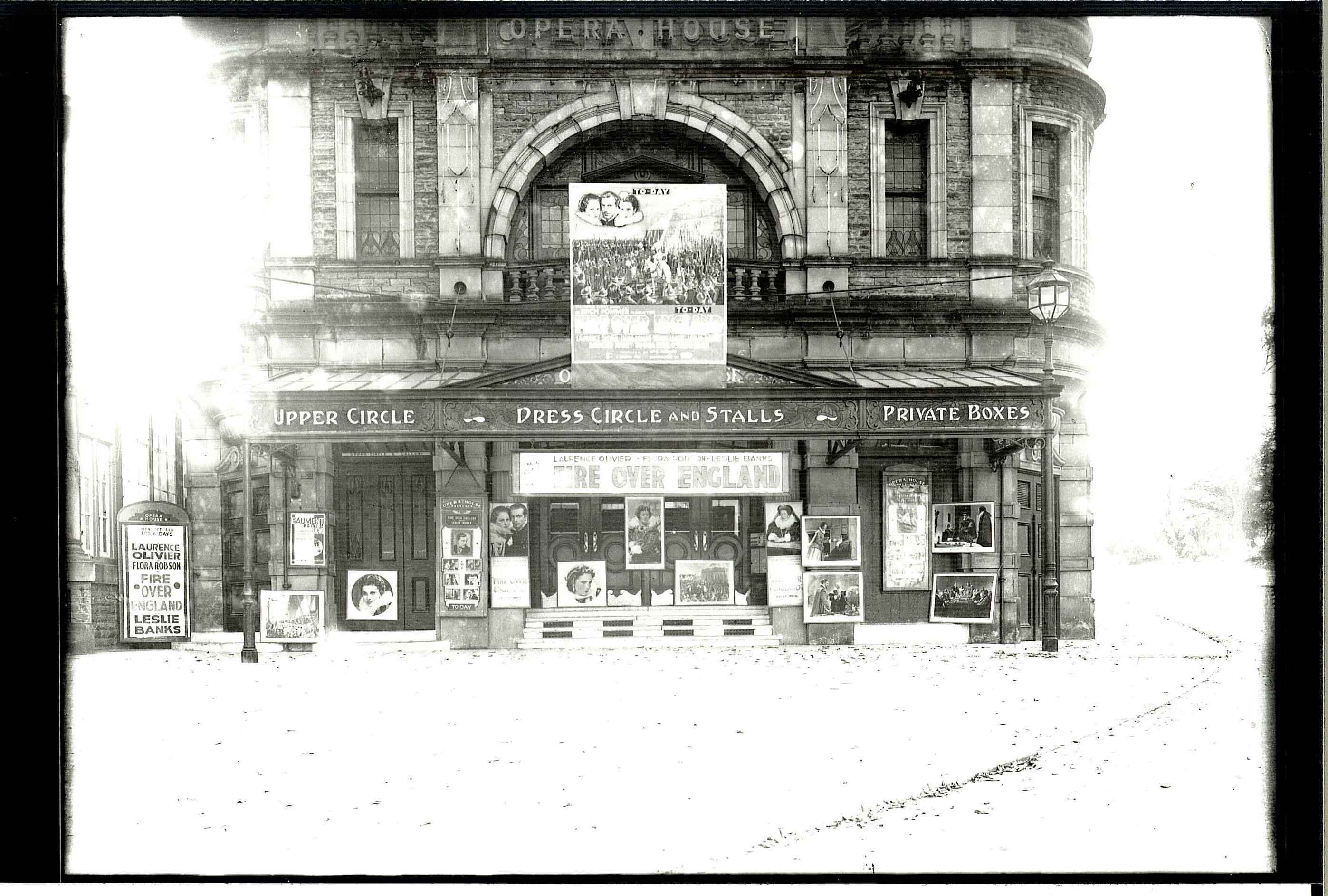 Exterior of Buxton Opera House 11th July 1937. At this time the building was also a cinema. 'Fire Over England', starring Laurence Olivier, is advertised.