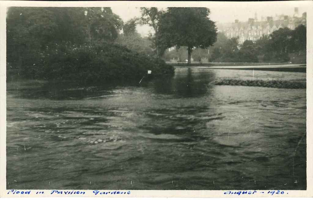 Postcard featuring a photograph of the flooded Pavilion Gardens, August 1920.