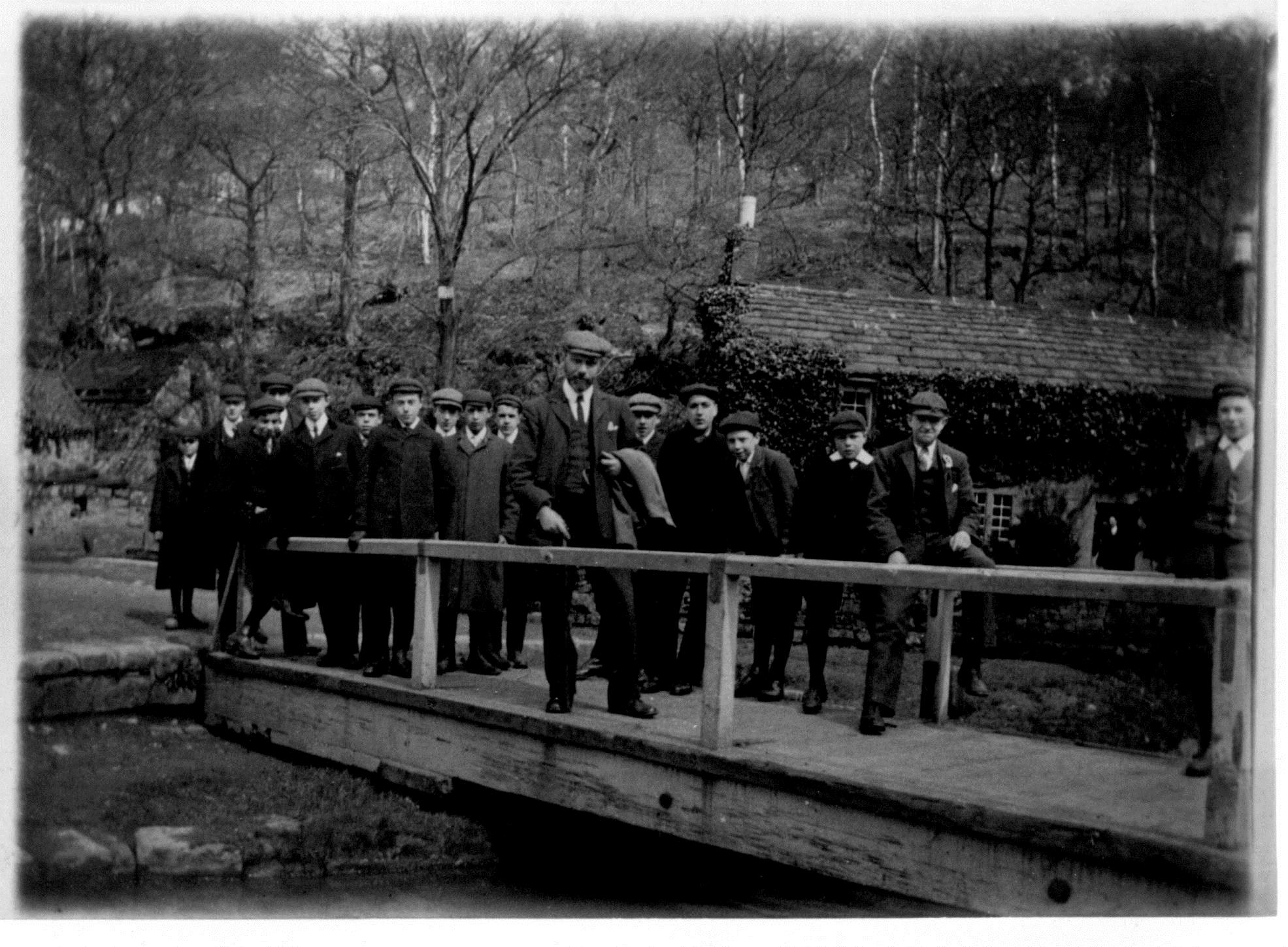 A group of school children with their teacher cross the bridge, probably in the 1930s. Can you identify anyone in the photograph?