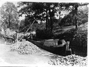 Historic image of boat being loaded